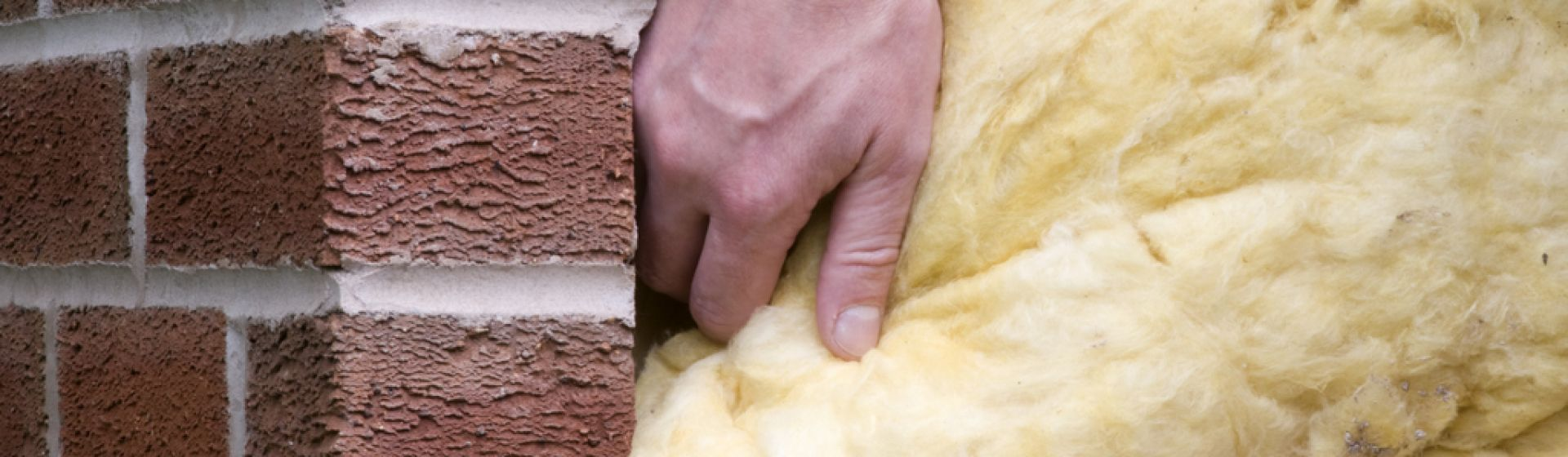 Man-putting-insulation-into-a-property-172975721_3432x2228